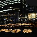 東京ミッドタウンの建物の明かりと、キャンドルの炎の共演も実に新鮮